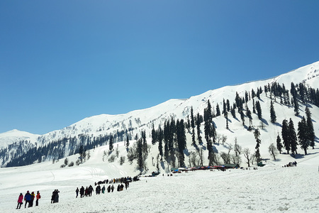 Scenic of tourists, activities and beautiful snow at Gulmarg; a popular skiing destination and a notified area committee in the Baramulla district of the Indian state of Jammu and Kashmir, shot from mobile camera.