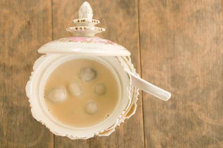 Rice dumpling stuffed with golden bean in warm coconut milk; Thai ancient dessert in Thai language called