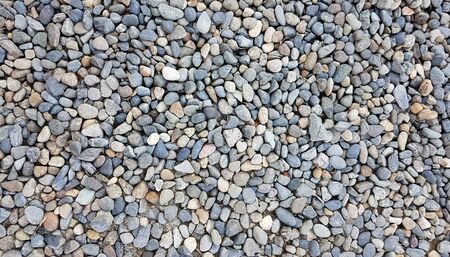 Background image of pebbles in various sizes and color; background and texture of gravels shoot by mobile camera.
