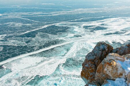 Beautiful scene of Lake Baikal ice surface in light blue and white color; and amazing texture pattern from high view point; scenic from cape in Olkhon island, Siberia, Russia.