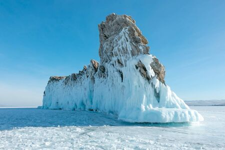 Ogoy island with icicles in winter set at Lake Baikal in Siberia; one of main travel attraction in Baikal, Russia; tourists can drive and walk on ice for take photo. 写真素材
