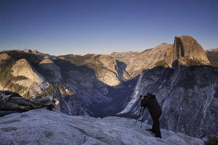 Photographer on Glacier Point - Yosemite National Park, CA Stock Photo
