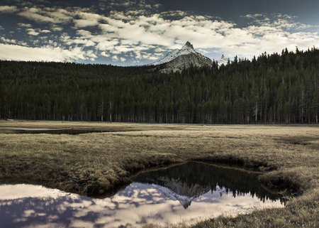 Cathedral peak reflected in a mountain tarn Stock Photo - 14773340