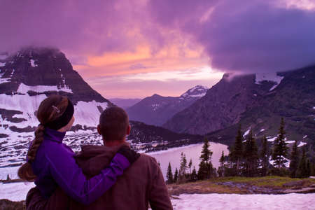 A Couple Watching the Sunset in the Mountains