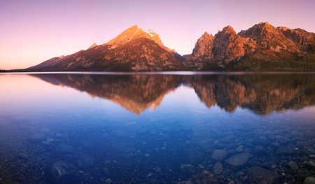 The Tetons Reflected in Jenny Lake Stock Photo