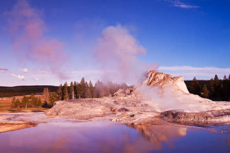 Castle Geyser Reflection - Yellowstone National Park Stock Photo