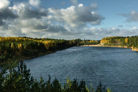 Autumn landscape, forest in a sunset light in Ogre Blue hills park, in Latvia