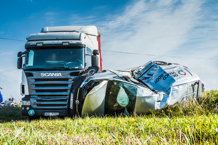 Car accident on a road in 20th of September 2018, car after a collision with a heavy truck, next to Inchukalns, Latvia, transportation background 免版税图像 - 115970788