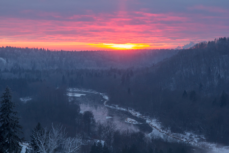 the valley of the river Gauja in winter in the rays of the sunset, landscape Stock Photo