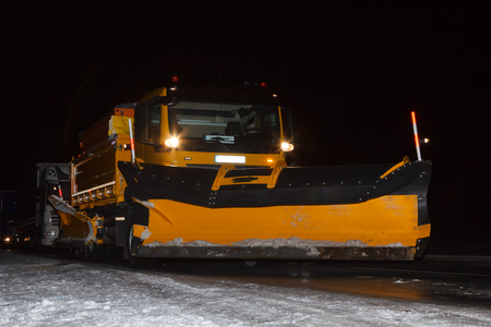 snow plow at night on slippery road in February Stock Photo - 121890166