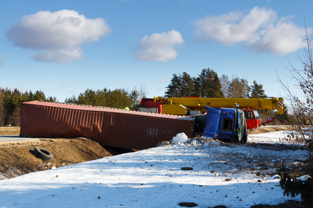 Car accident on a road in February 22, 2019 truck driver lost control over vehicle drove off the road and overturned, transportation background Stock Photo