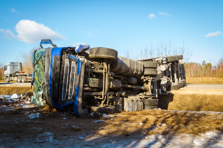 Car accident on a road in February 22, 2019 truck driver lost control over vehicle drove off the road and overturned, transportation background Stock Photo - 121890173
