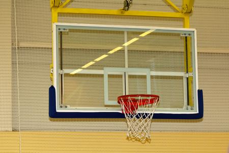 Basketball basket in school sport hall, sport background