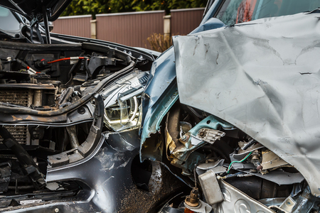 Car accident on a road in March,from parts of cars after collision, transportation background Stock Photo