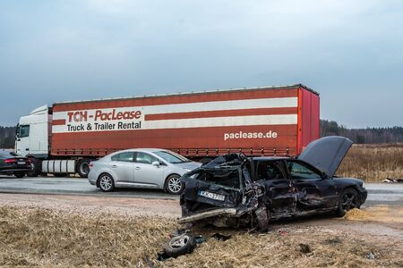 Car accident of three vehicles on A5 road in 4th of April 2018, cars after a collision with a heavy truck, in Latvia next to Kekava, transportation background