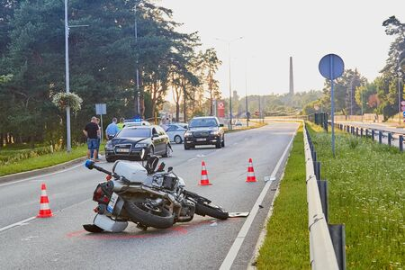 Car accident on a road in 24th of June 2019 in Ogre Latvia, police motorcycle after a collision with a car, transportation background Editorial