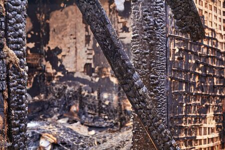 charred wooden parts of a burnt house Stock Photo