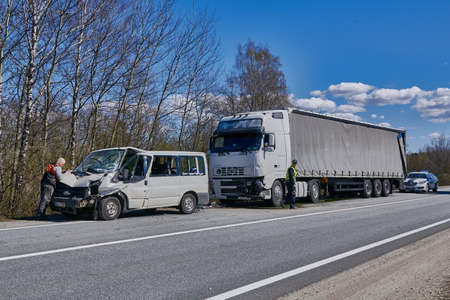 April 22, 2020, Upesciems Latvia: car accident on a road, truck after a collision with a van, transportation background