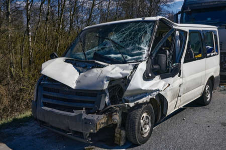car accident on a road, van after a collision with a truck, transportation background Stock Photo