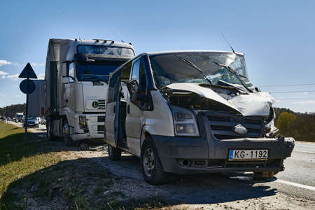April 22, 2020, Upesciems Latvia: car accident on a road, van after a collision with a truck, transportation background Editorial