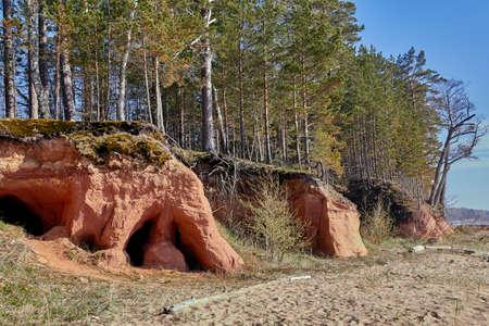 Cave at Baltic sea rocky shore near Tuja, Veczemju klintis, Vidzeme, Latvia, landscape Banco de Imagens