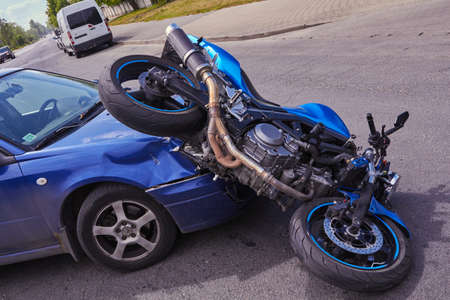 June 6, 2020, Riga, Latvia, damaged car and motorbike on the city road at the scene of an accident
