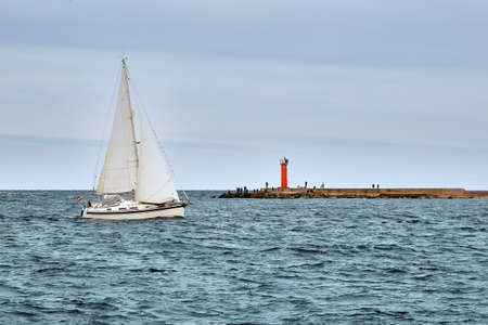 Pleasure boat is sailing from harbor to the Gulf of Riga