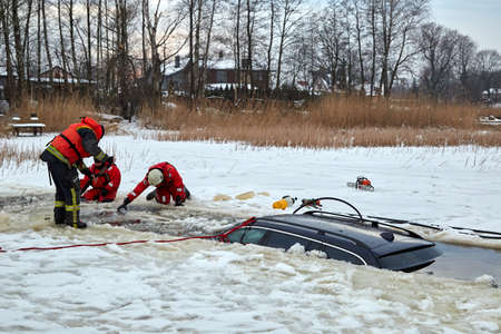 January 21, 2021, Baltezers, Latvia: The work of the rescue service to retrieve the car from the water. The car broke into the ice Editorial