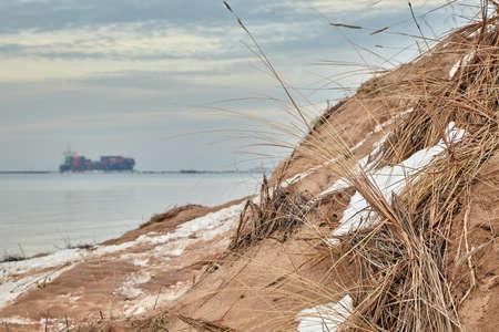 sandy coast of the Baltic Sea near the entrance to the port of Riga, Latvia in winter Stock Photo