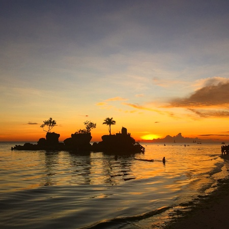 sillhouette: Willys Rock at sunset in Boracay island Stock Photo