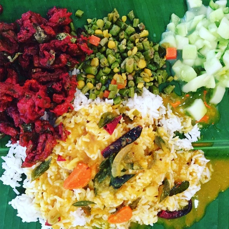 gulp: Nothing is more satisfying than having banana leaf rice with lots of curry for lunch. Make sure you gulp down a glass of salty yoghurt Stock Photo