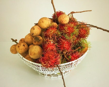 Malaysia is abound with delicious local fruits such as these rambutans and duku langsat. Stock Photo