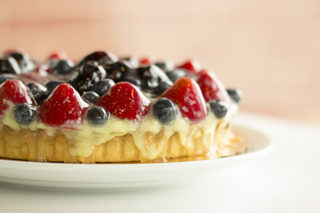 Fruit tart with strawberries and blueberries.