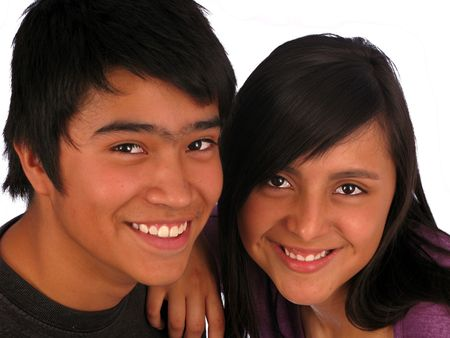 Happy teenager smiling couple over white