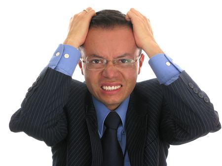 Businessman looking upset, pulling his hair off. Stock Photo - 4632615