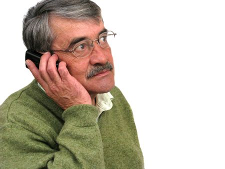 latin american: Senior business man talking on his mobile phone isolated on a white background