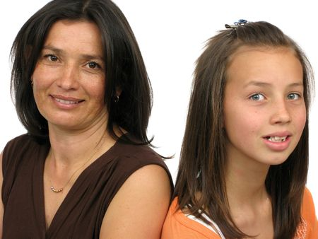 Isolated portrait of a mother posing with her lovely daughter. Stock Photo - 4757467