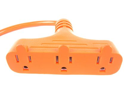 plugged: Plug, plugged into an outlet shot over white background  Stock Photo