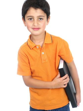 Boy holding a notebook isolated over white background photo