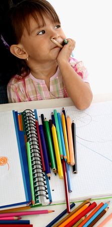 A blond caucasian girl child toddler painting a picture  photo