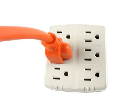corded: Wall Outlet with Orange corded Plug over white