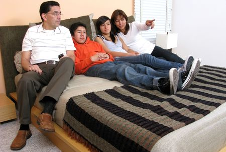 Big family look television indoor bedroom Stock Photo - 5695106