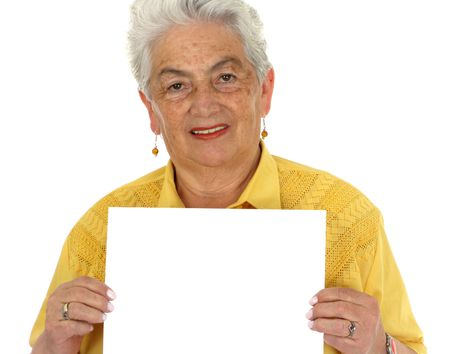 An older smiling woman in a yellow shirt whit a banner Stock Photo