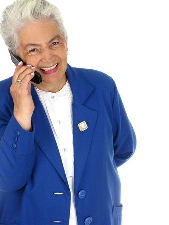 Smiling senior woman talking on cell phone photo