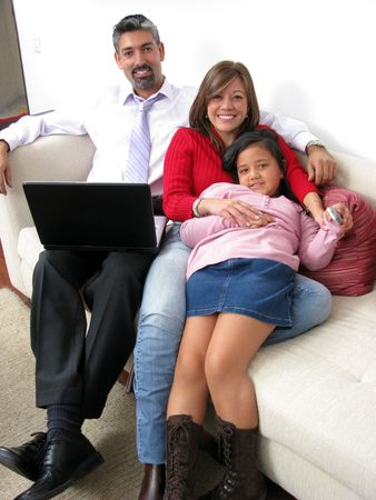 Parents whit son look in notebook and television