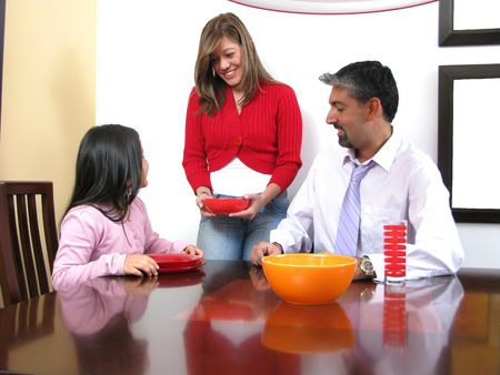 Family smiling and dining in the apartment Stock Photo - 6410158
