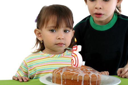 blowing out: Childrens happy blowing out her birthday candels Stock Photo