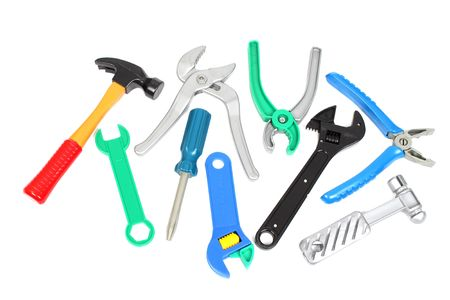 alicates: Conjunto de herramientas de juguete de pl�stico sobre fondo blanco