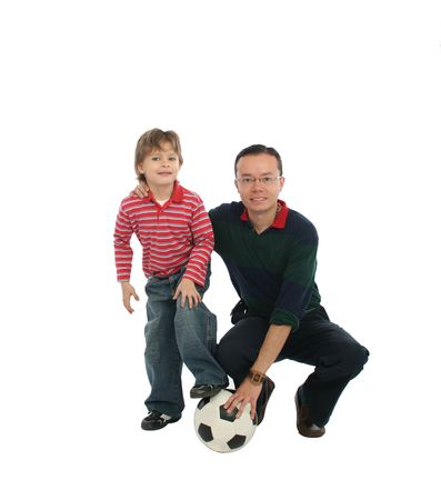 Happy father playing with his son football  photo