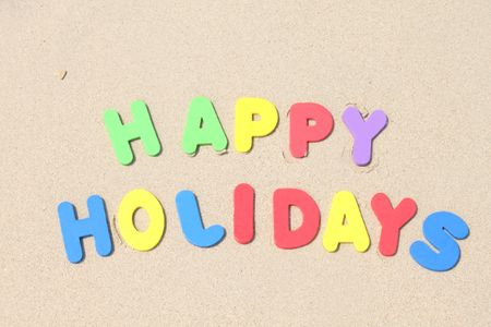 happy holidays text: Happy Holidays text written with plastics letters colours.  Stock Photo